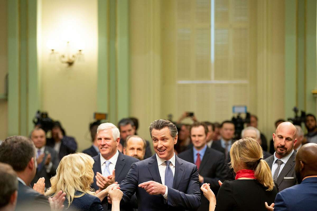 Gov. Gavin Newsom greets assembly members before he delivers the State of the State on Feb. 12, 2019, in Sacramento.