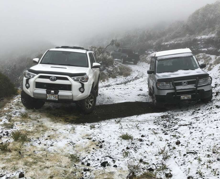 """This Sunday, Feb. 10, 2019, photo shows snow on the ground in Polipoli Spring State Recreation Area in Kula, Hawaii on the island of Maui. A strong storm that hit Hawaii knocked out power, brought down tree branches, flooded coastal roads€"""" and even brought snow. Snow is not unheard of in mountainous parts of the tropical island chain, but officials say the coating at 6,200 feet (1,900 meters) at a state park on Maui could mark the lowest-elevation snowfall ever recorded in the state. Photo: Lance Endo/AP"""
