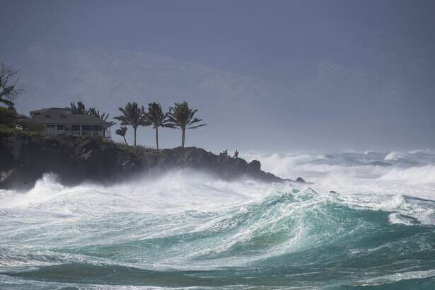 "In this photo taken Feb. 10, 2019, rough surf hits Oahu's Waimea Bay near Haleiwa, Hawaii. A strong storm hit Hawaii and knocked out power, brought down tree branches, flooded coastal roads �"" and even brought snow. The National Weather Service said gusts hit nearly 70 mph (110 kph) in some areas. A high-surf advisory was in effect for north- and west-facing shores of several islands."