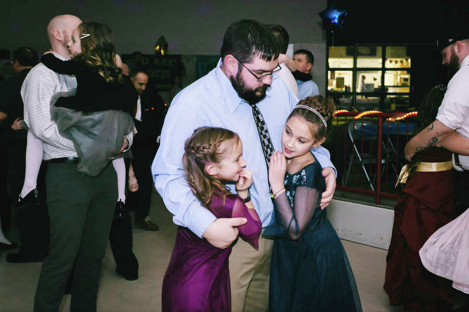 Nearly 225 princesses and kings attended the Blue and Gold Ball on Friday at Bad Axe High School. After dinner was served, the night was dedicated to some daddy-daughter dancing. The event was sponsored by the Hatchet softball team and was open to all kindergarten through sixth grade girls and their fathers/grandfathers. Photo: Courtesy Photo / Abbie Marie Photography