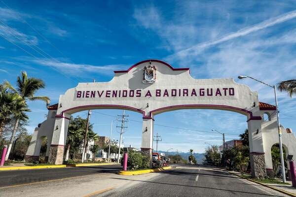 """View of an entrance reading """"Welcome to Badiraguato"""" in Badiraguato -Mexican mobster Joaquin """"El Chapo"""" Guzman's hometown-, Sinaloa State, Mexico on February 8, 2019. - If """"El Chapo"""" returned to Badiraguato it would be a relief for its inhabitants because, according to them, there was neither poverty nor violence when he was there. Guzman was found guilty Tuesday by a New York jury of crimes spanning a quarter of a century as head of one of the world's most powerful drugs gangs. (Photo by RASHIDE FRIAS / AFP)RASHIDE FRIAS/AFP/Getty Images"""