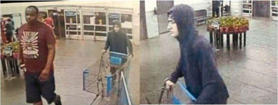 Two men are seen entering a Walmart in Porter which authorities say they robbed before fleeing in a Kia Soul. Photo: Courtesy Of The Montgomery County Sheriff's Office