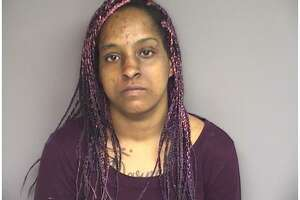 Camille Alexander, 33, of New York, was charged with sixth-degree larceny, credit card theft and conspiracy to commit credit card theft.