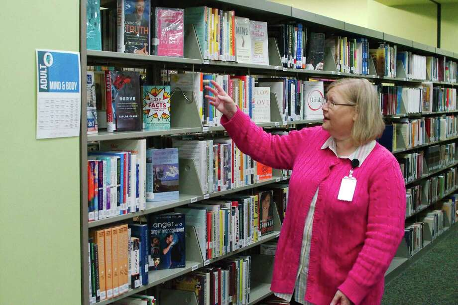 Deer Park Library director Rebecca Pool explains the new way the library is organizing its collection as it moves away from the Dewy Decimal System in favor of more word-based plan similar to that of a bookstore. Photo: Kirk Sides / Staff Photographer / © 2018 Kirk Sides / Houston Chronicle