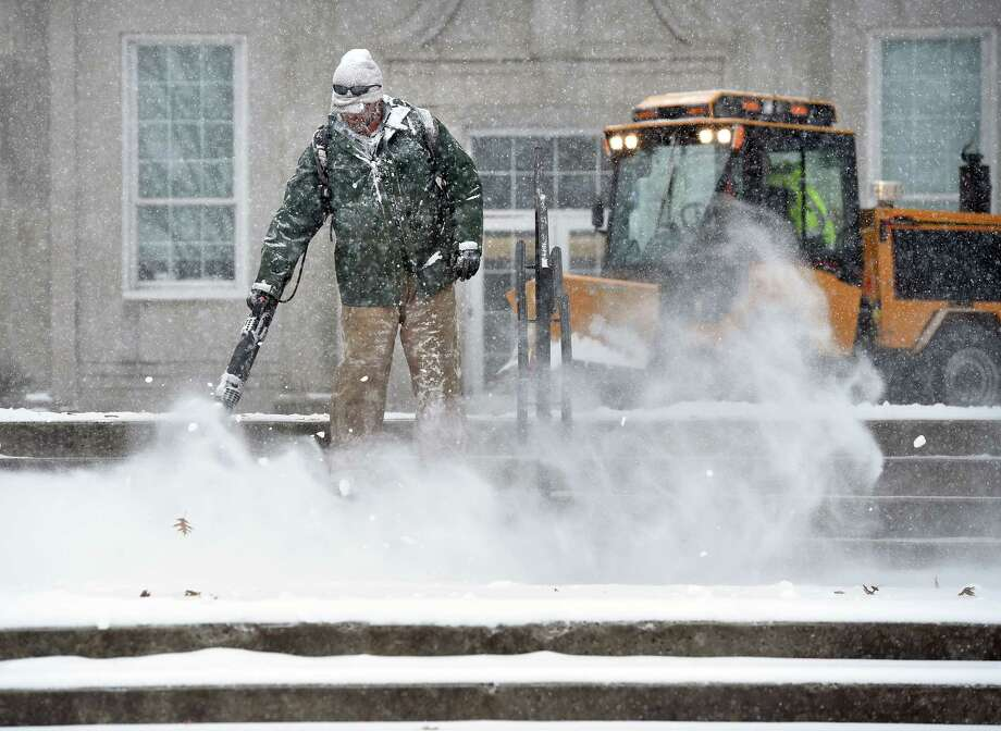 Bud Schoenster of the Milford Public Works Department clears snow from steps in front of the Parsons Government Center in Milford on February 12, 2019. Photo: Arnold Gold, Hearst Connecticut Media / New Haven Register