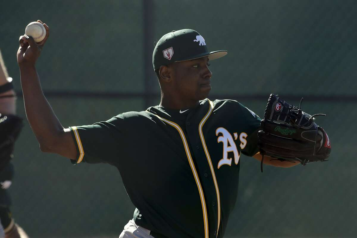 Oakland Athletics starting pitcher Jharel Cotton works out at their baseball spring training facility in Mesa, Ariz., Tuesday, Feb. 12, 2019. (AP Photo/Chris Carlson)