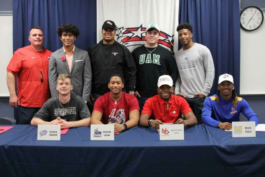 Dawson football players, shown with head coach Mike Allison, signing national letters of intent included Marcus Allen (Universidad De Las Americas Puebla), Spencer Cody (Northwestern State), Jacob Johnston (Arkansas-Monticello), Patrick Kramer (Southwestern College,Kan.), Devon Leon (Sterling College), Kris Levi Navarro JC), Mason Pierce (McNeese State) and Steven Rochon (Air Force). Eagle baseball player Shawn Huber signed with Concordia University. Photo: Submitted Photo