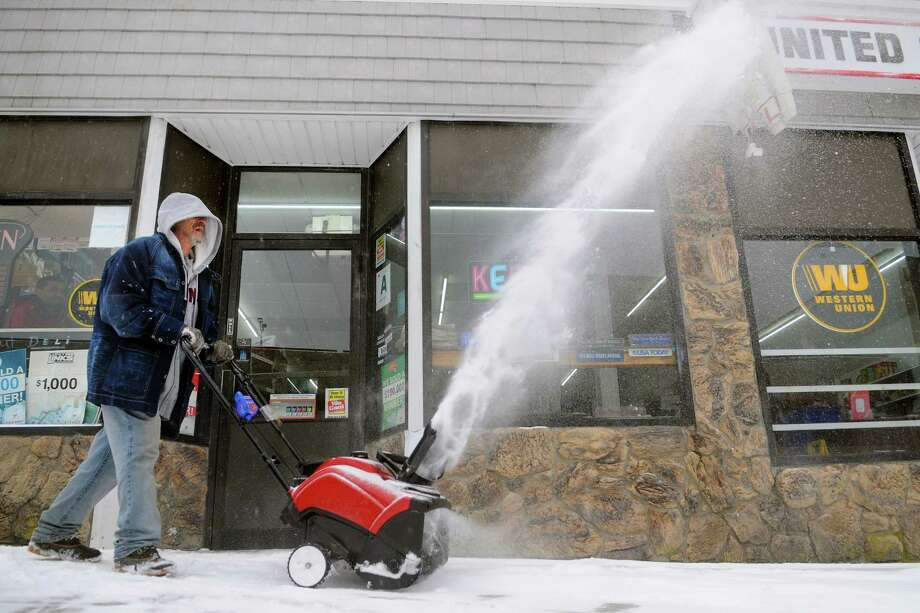 John Barber uses a snow blower to remove snow in front of United Cigarl along Elizabeth Street in Ansonia, Conn., on Tuesday, Feb. 12, 2019. Photo: Christian Abraham, Hearst Connecticut Media / Connecticut Post