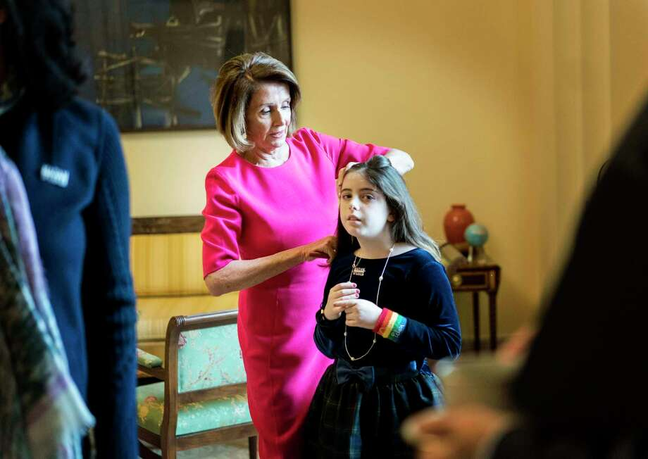Nancy Pelosi fixes the hair of granddaughter Bella Kaufman in the Speaker's Office on Capitol Hill. Pelosi, a mother of five and a grandmother of nine, says that being a parent shaped her in the years before she got into politics. Photo: Washington Post Photo By Melina Mara / The Washington Post