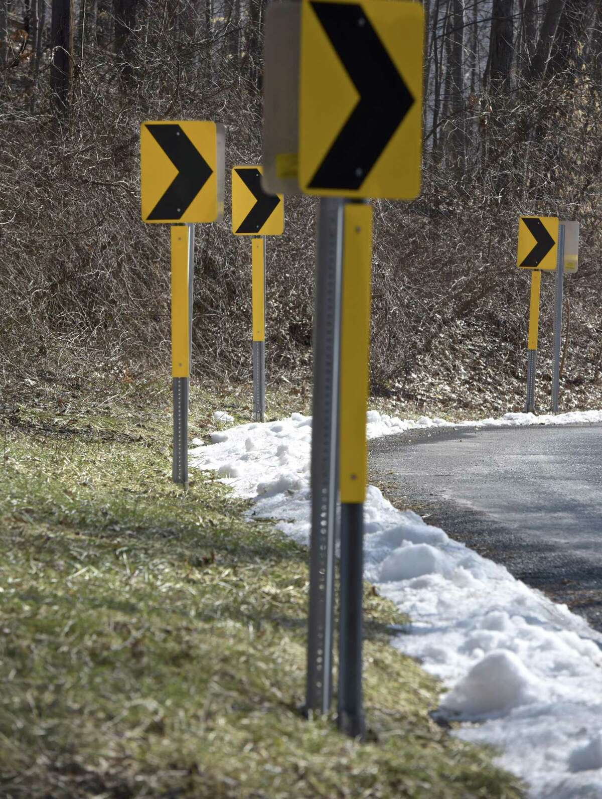 Curve signs on Feb. 5, part of federal grant to make roads safer, installed on Big Bear Hill Road in New Milford.