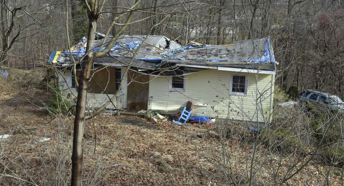 A house of Main Drive in Brookfield damaged in May's microburst awaits repairs.
