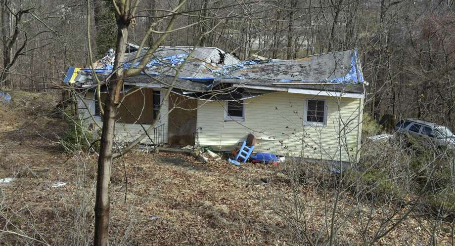 A house of Main Drive in Brookfield damaged in May's microburst awaits repairs. Photo: H John Voorhees III / Hearst Connecticut Media File Photo / The News-Times