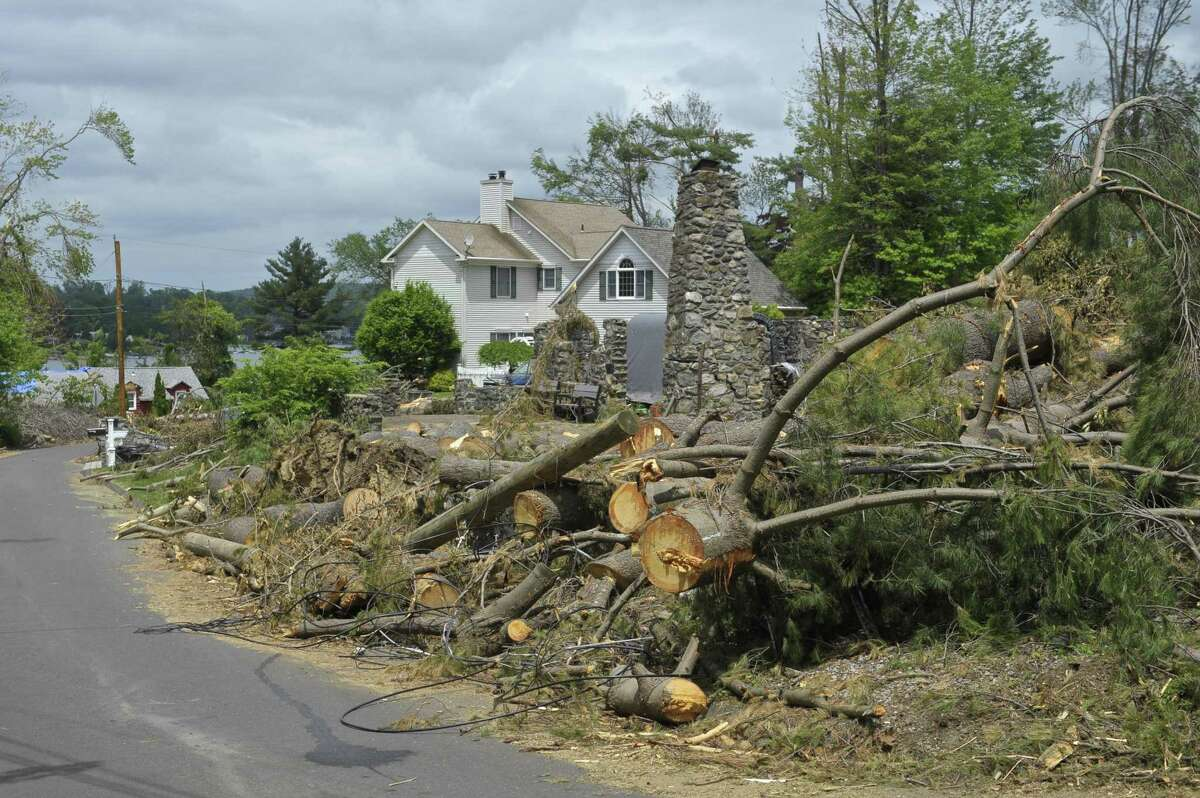 Remaining storm damage cleanup on Pocono Point Road, on Thursday, May 31, 2018, in Danbury, Conn.