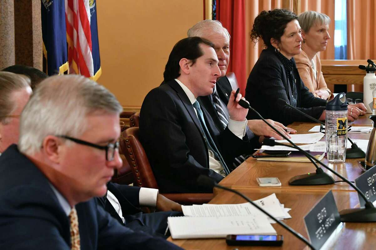 """Senator Todd Kaminskyat, Chair of the Environmental Conservation Committee, fourth from right, leads a public hearing on the Climate & Community Protection Act (?'CCPA?"""") at the New York State Capitol on Tuesday, Feb. 12, 2019 in Albany, N.Y. (Lori Van Buren/Times Union)"""
