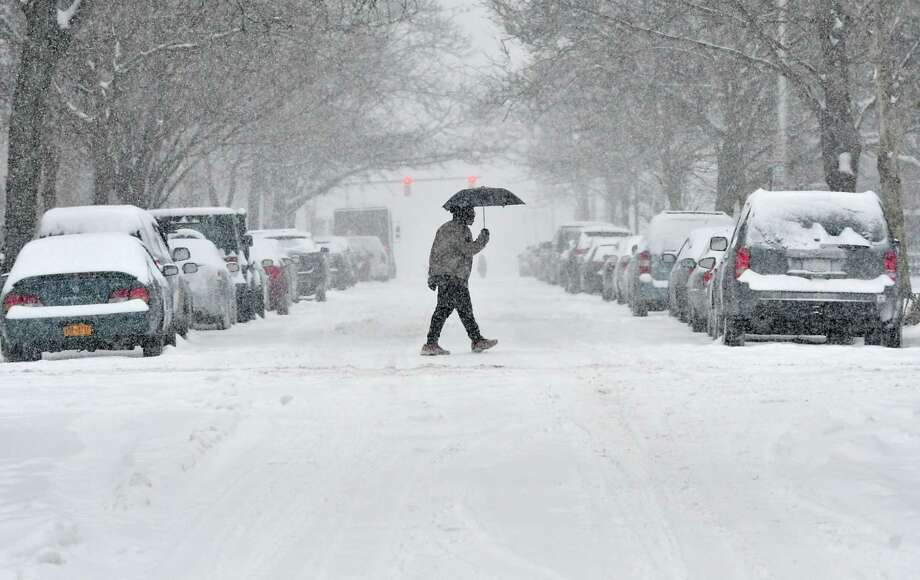 A pedestrian crosses State St. during a snow storm on Tuesday, Feb. 12, 2019 in Albany, N.Y. (Lori Van Buren/Times Union) Photo: Lori Van Buren, Albany Times Union / 20046171A