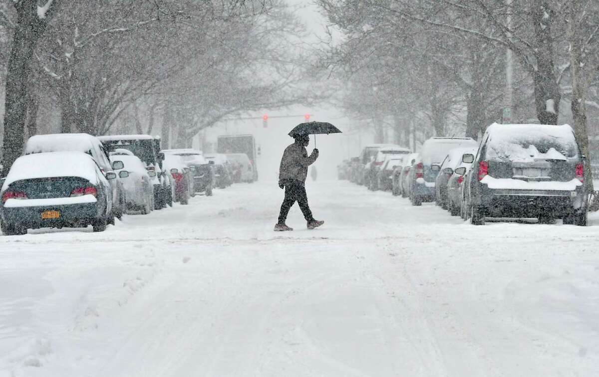 A pedestrian crosses State St. during a snow storm on Tuesday, Feb. 12, 2019 in Albany, N.Y. (Lori Van Buren/Times Union)