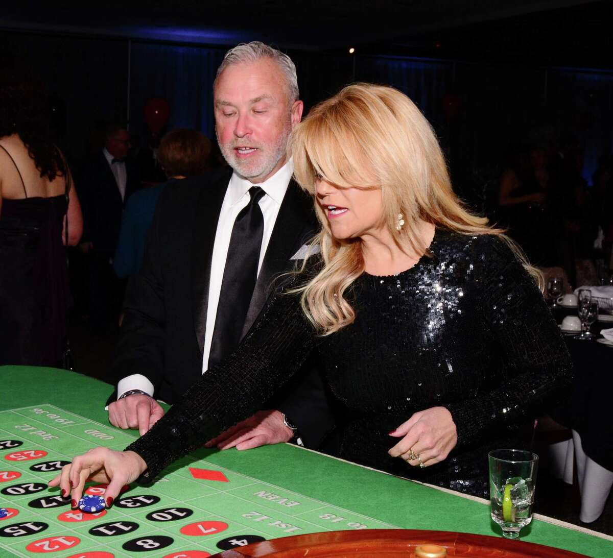 Ken Taylor and Judy Huntington get in on the action at the roulette table at the Greater New Milford Chamber of Commerce's 21st annual Crystal Winter Gala.