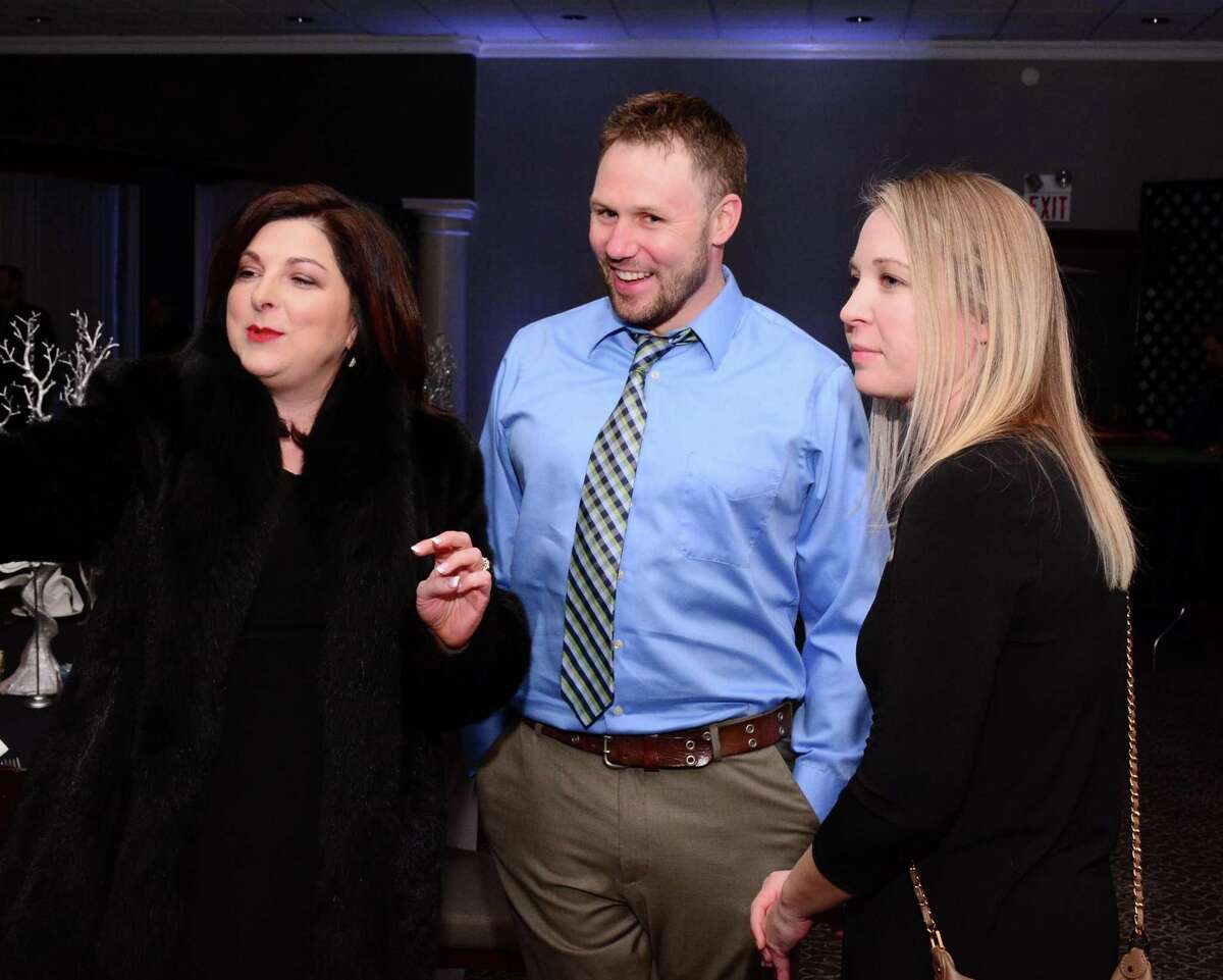 Affordable Automotive's Rose Koulouris, left, visits with Jake and Kim Moran during the evening's festivities.