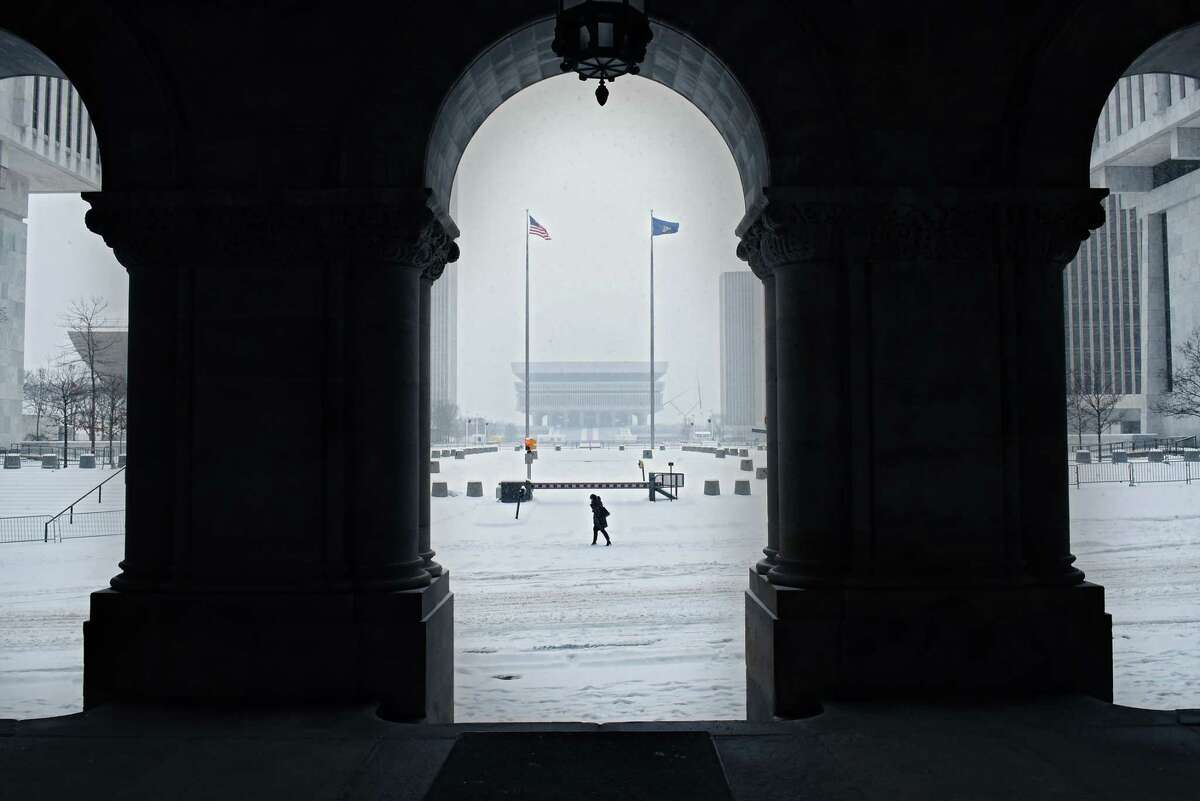 A pedestian walks down State St. during a snow storm on Tuesday, Feb. 12, 2019 in Albany, N.Y. (Lori Van Buren/Times Union)