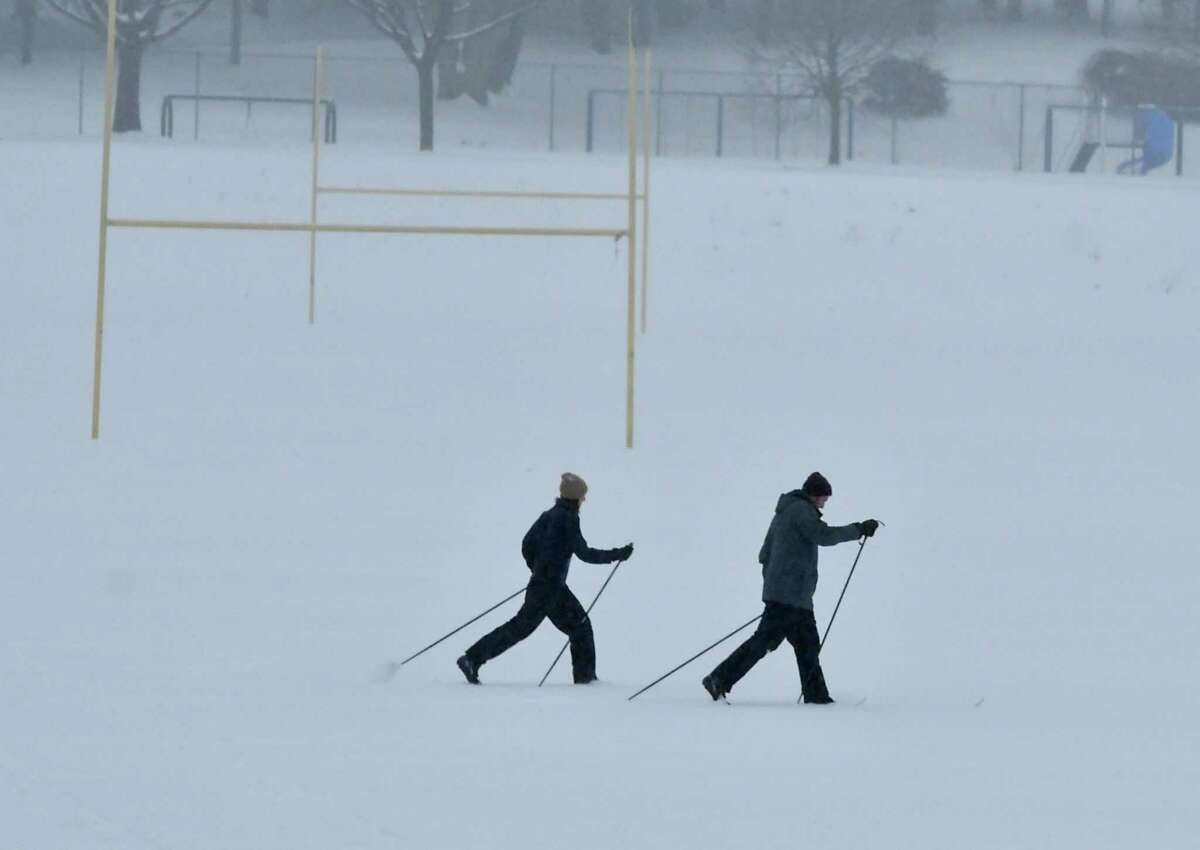 This might be the best way to get to school and work on Wednesday, a day after a sloppy storm covered the region in snow and sleet. In this photography, Julie Nociolo and Greg Mumby of Albany cross-country ski in Lincoln Park during Tuesday's snow storm. (Lori Van Buren/Times Union)