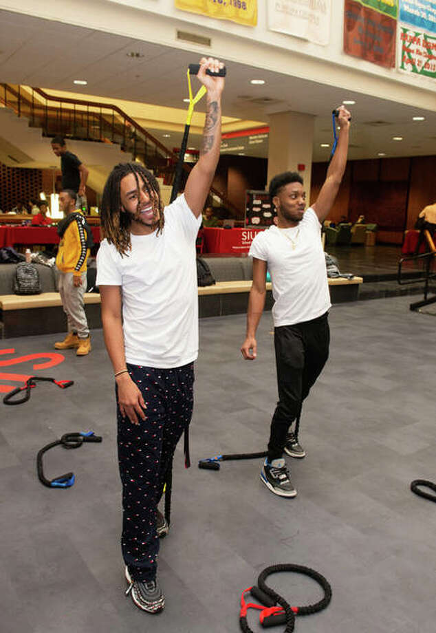 Trenton Banks, left, a sophomore majoring in computer management information systems; and Kamaron Williams, a freshman business major, enjoy strength training at the SIUE Health Awareness Fair. Photo: For The Telegraph