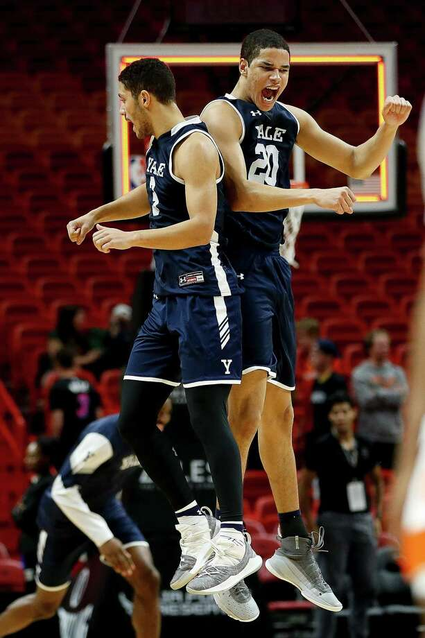 Yale's Paul Atkinson (20) and Alex Copeland celebrate after defeating Miami in the HoopHall Miami Invitational at American Airlines Arena on Dec. 1. Photo: Michael Reaves / Getty Images / 2018 Getty Images