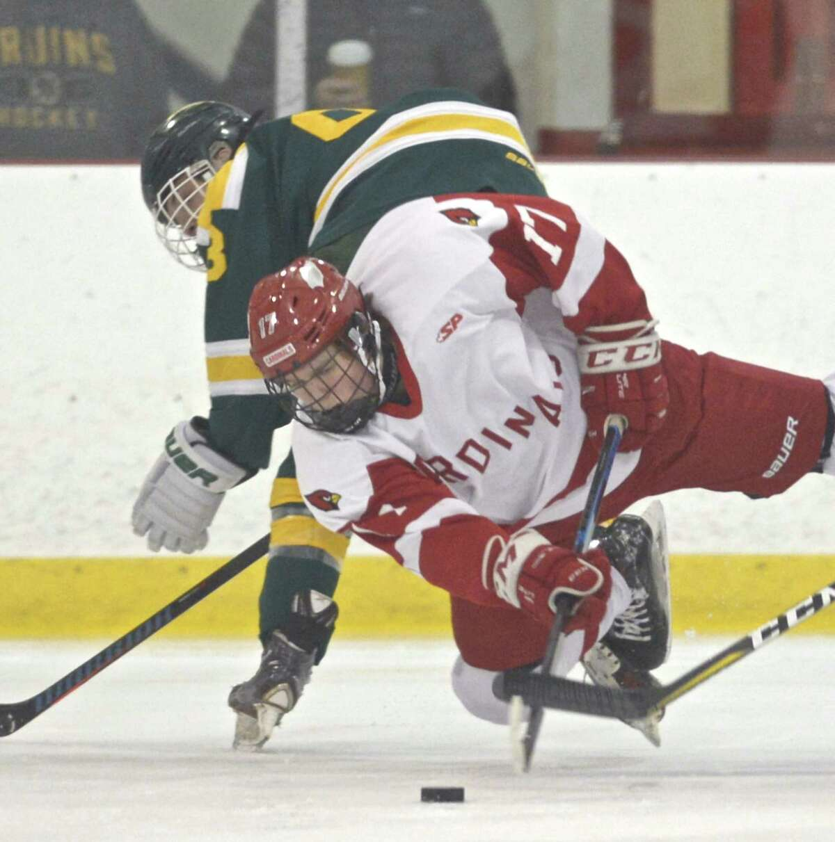 Greenwich's Thatcher Danielson (17) gets airborne as he goes for the puck in the boys ice hockey game between Hamden and Greenwich high schools, Tuesday night, January 2, 2019, at Dorothy Hamill Rink, Greenwich, Conn..