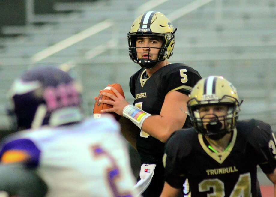 Trumbull quarterback Colton Nicholas has signed to play football at Sacred Heart University. Photo: Christian Abraham / Hearst Connecticut Media / Connecticut Post