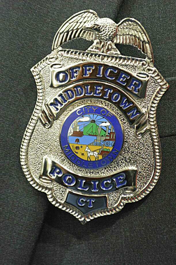 The Middletown Police Department is now up to 112 law enforcement officers after three took the oath of office Friday afternoon in Council Chambers. Photo: Cassandra Day / Hearst Connecticut Media /