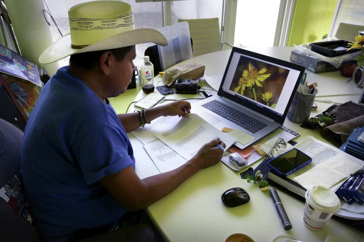 Max Munoz,, Grounds Manager at the National Butterfly Center, catalogues flowers found at the center. Plans are for the border wall to be built along the levee that will cut The National Butterfly Center in half. The NBC is near Mission, TX.