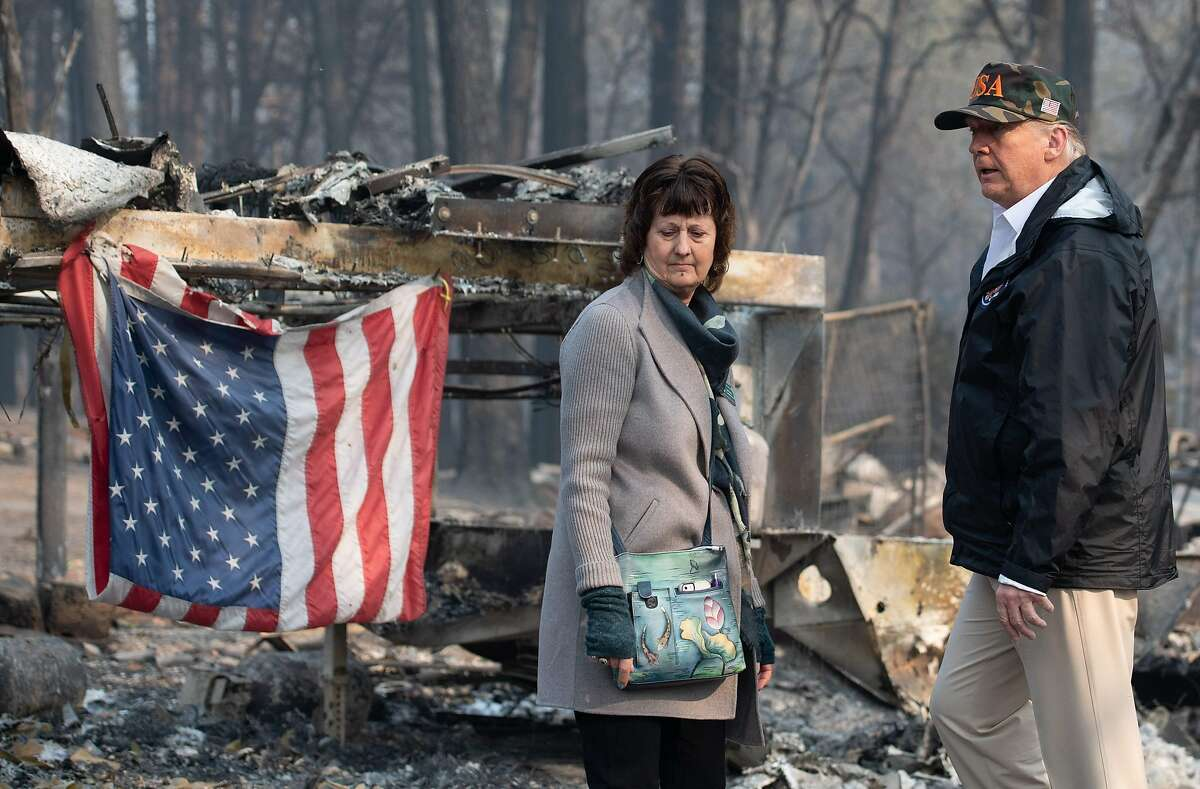"""US President Donald Trump and Paradise Mayor Jody Jones view damage from the Camp fire in Paradise, California on November 17, 2018. - President Donald Trump arrived in California to meet with officials, victims and the """"unbelievably brave"""" firefighters there, as more than 1,000 people remain listed as missing in the worst-ever wildfire to hit the US state. (Photo by SAUL LOEB / AFP)SAUL LOEB/AFP/Getty Images"""