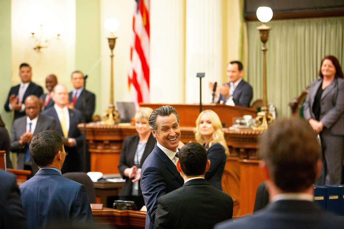 Gov. Gavin Newsom greets assembly members before he delivers the State of the State address at the California State Capitol on Tuesday, Feb. 12, 2019, in Sacramento.