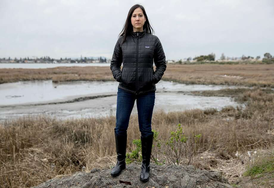 Save the Bay's Allison Chan poses for portrait along a trail near Damon Slough along Highway 880 in Oakland, Calif. Tuesday, Feb. 12, 2019. This slough is a common place for trash to accumulate from the freeway and other major roadways. Photo: Jessica Christian / The Chronicle