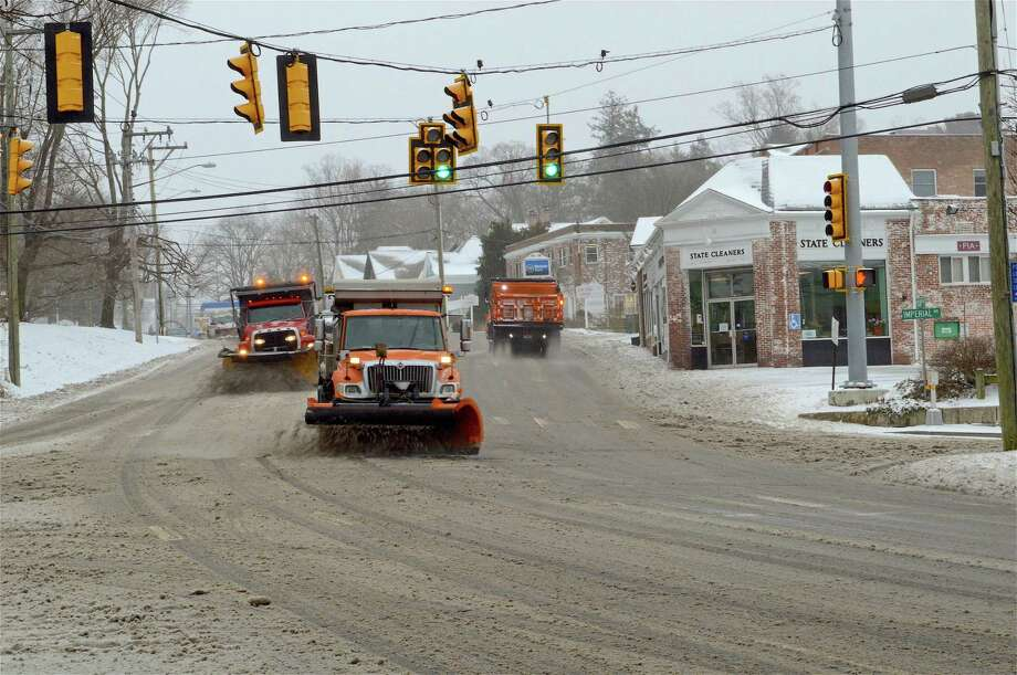 The state fleet from the DPW plows the Post Road, looking eastbound at the corner of Imperial Avenue, during the snowy day on Tuesday, Feb. 12, 2019, in Westport, Conn. Photo: Jarret Liotta / For Hearst Connecticut Media / Westport News Freelance
