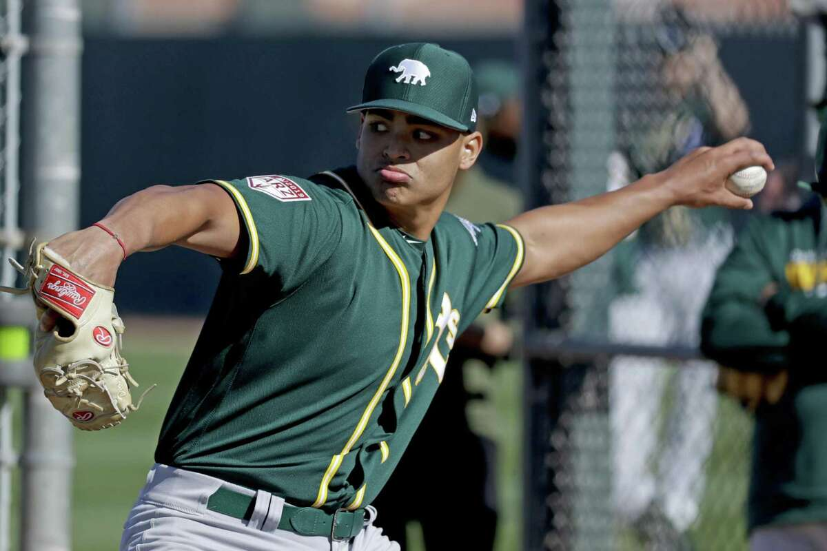 A's prospect Jesus Luzardo, throwing at spring training in Mesa, Ariz., posted a 2.88 ERA across three levels last year.