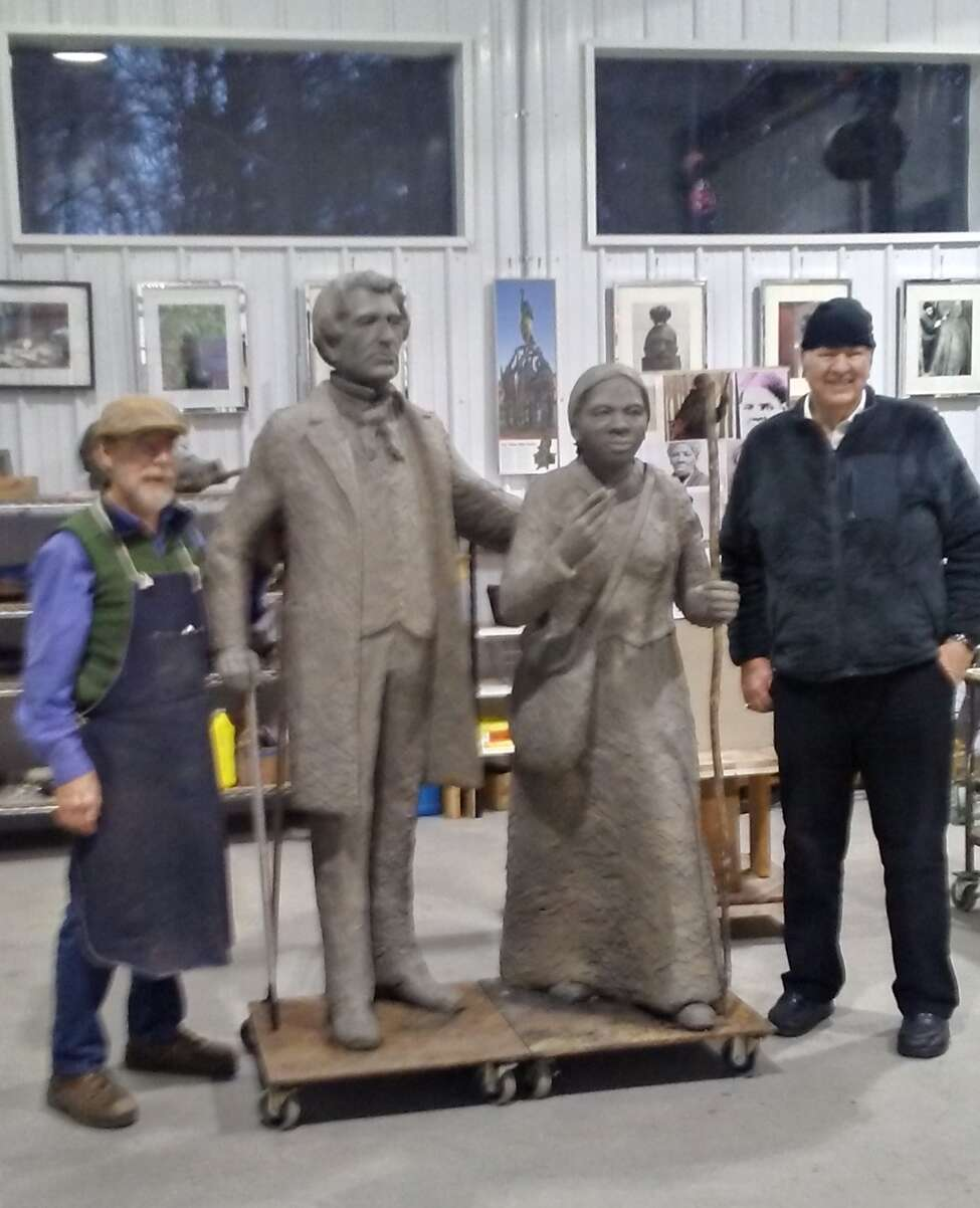 From left, sculptor Dexter Benedict with life-sized sculptures of William Henry Seward and Harriet Tubman with lead Frank Wicks at Benedict's studio outside Penn Yan in Yates County.