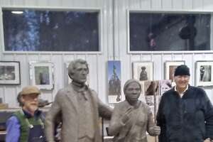 From left, sculptor Dexter Benedict with life-sized sculptures of William Henry Seward and Harriet Tubman with lead Frank Wicks at Benedict?s studio outside Penn Yan in Yates County.