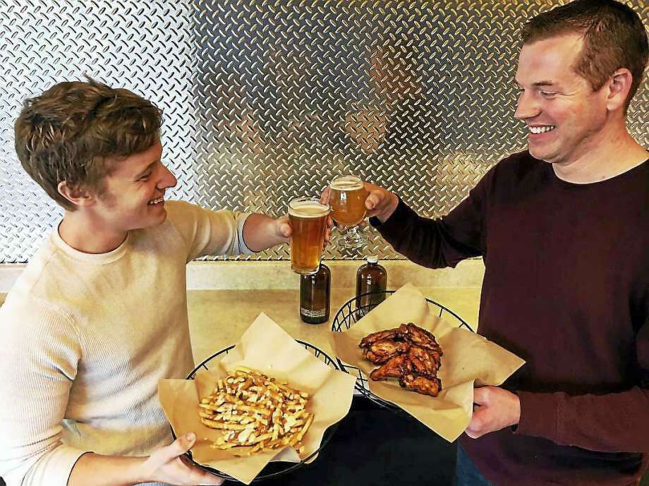 Hop Knot founders John Schauster, left, and Michael Boney in 2016. In February 2018, Schauster has been promoting the pending opening of Proof in Bethel, Conn., with the eatery following the Hop Knot focus on gourmet pretzels and craft beer. (Middletown Press file photo) Photo: /