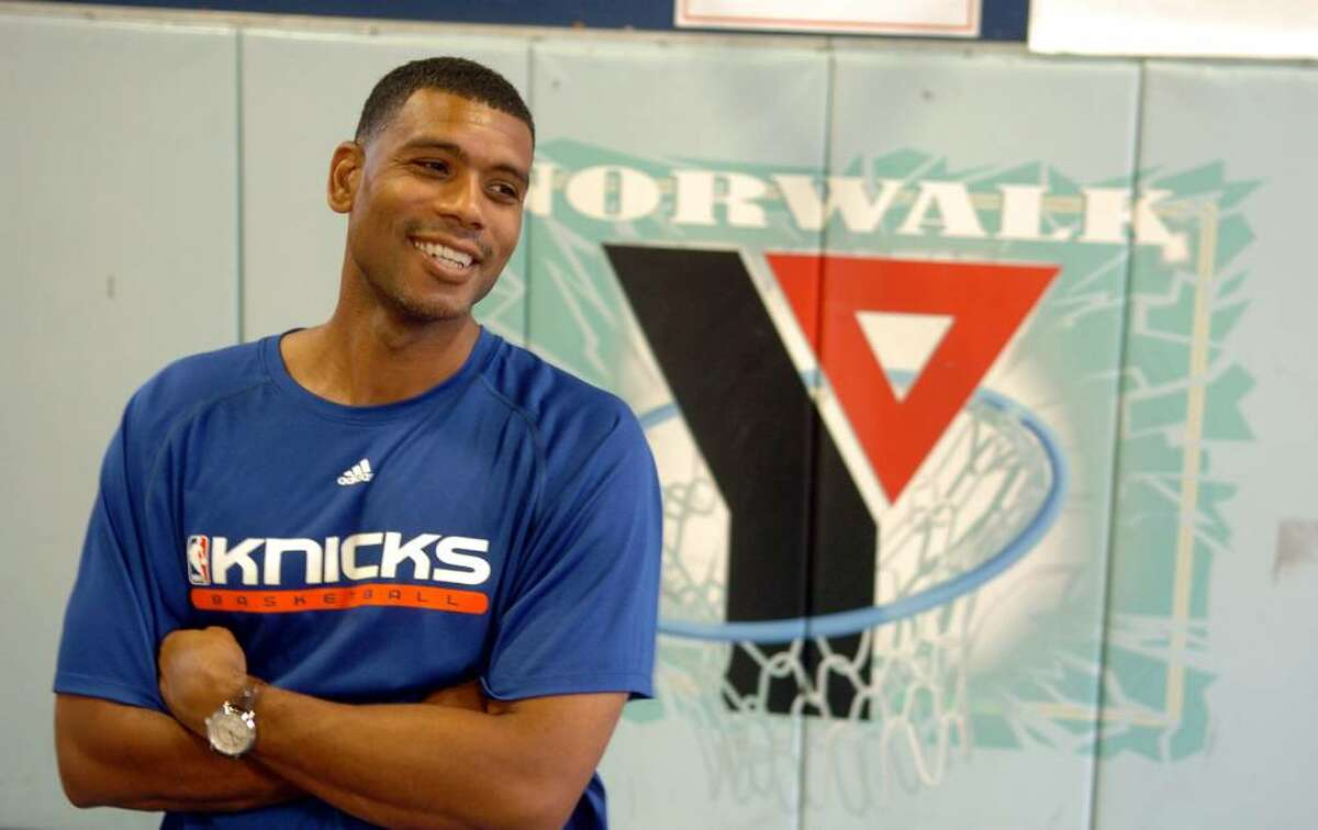 Former NBA player Allan Houston visited the YMCA in downtown Norwalk, Conn. to kick off the F.I.S.L.L. program for area youths on Thursday July 22, 2010. The program's name F.I.S.L.L. stands for faith, integrity, sacrifice, leadership, and legacy. Here, Houston answers the media's questions before starting the program.