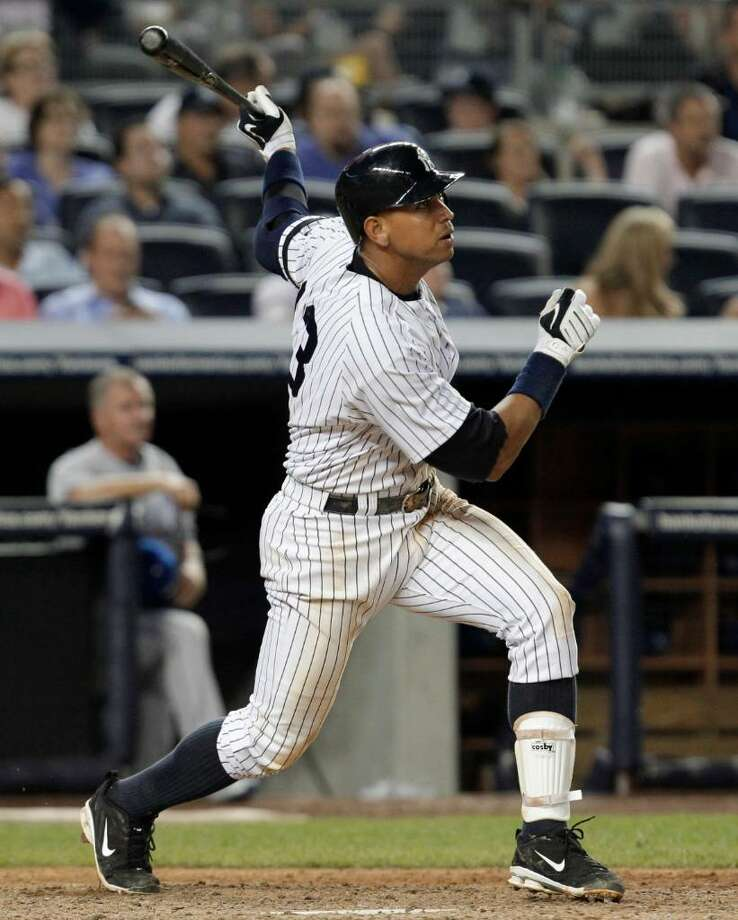New York Yankees Alex Rodriguez watches his 599th career home run, in the seventh inning off Kansas City Royals reliever Robinson Tejada, in a baseball game at Yankee Stadium on Thursday, July 22, 2010 in New York. (AP Photo/Kathy Willens) Photo: AP