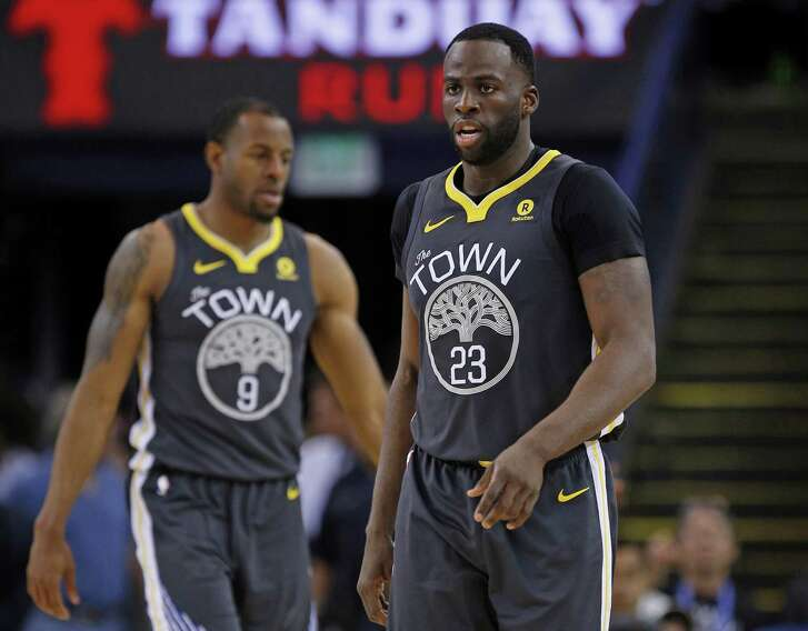 Golden State Warriors forward Draymond Green (23) and forward Andre Iguodala (9) during an NBA game between the Warriors and New Orleans Pelicans at Oracle Arena on Saturday, April 7, 2018, in Oakland, Calif. The Warriors lost 126-120.