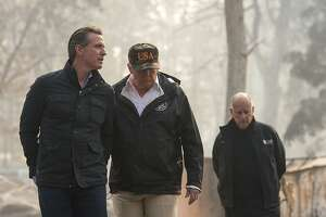 President Donald Trump talks with California Gov.-elect Gavin Newsom during a visit to a neighborhood destroyed by the wildfires, Saturday, Nov. 17, 2018, in Paradise, Calif. At right is California Gov. Jerry Brown. (Paul Kitagaki Jr./The Sacramento Bee via AP, Pool)