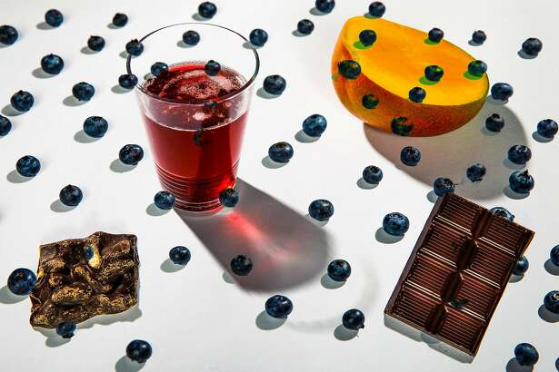 Blueberries, mangos, chocolate, pomegranate juice and beer, seen on Tuesday, Feb. 12, 2019 in San Francisco, Calif., are among foods with health benefits that should be re-examined.