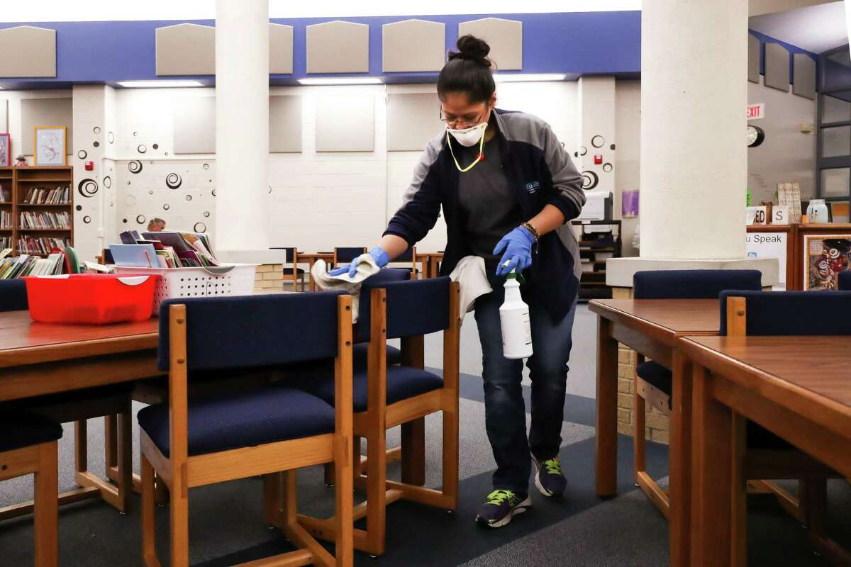 An employee for Aqua One sanitizes a room at the Newton Elementary School on Tuesday. The cleaning was response to a school employee being diagnosed with meningitis. Photo provided by Heather Foster