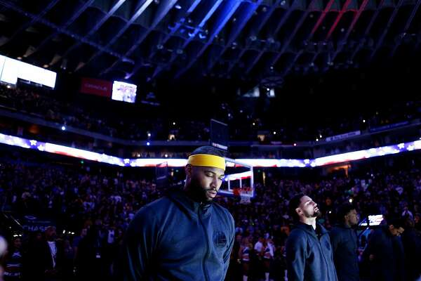 9a3d055d0 1of15From left  Golden State Warriors center DeMarcus Cousins (0) and guard  Klay Thompson (11) during the playing of the U.S. national anthem before an  NBA ...