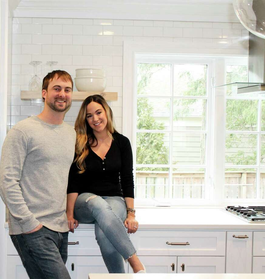 Travis and Felicia Gulick of Madison in one of the homes on which they've worked. Photo: Contributed Photo / Travis Gulick