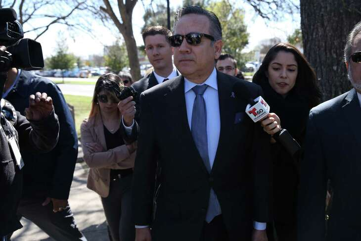 """James """"Jimmy"""" T. Dutchover, a former Texas credit union CEO who worked on disgraced ex-San Antonio lawmaker Carlos Uresti's staff, was sentenced on a bank fraud charge to eight months in prison by a Pecos federal judge Monday. Dutchover in May had pleaded guilty to one count of conspiracy to commit bank fraud in connection with a loan he made for the benefit of Uresti, 56. Shown is Uresti arriving in February at the San Antonio federal courthouse. He is serving a 12-year prison sentence on charges in an unrelated case."""