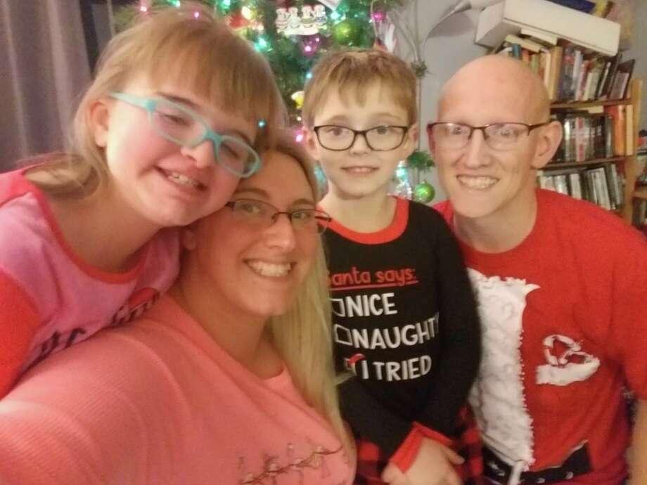 Torrington resident Kirsten Viargeno is pictured with, her husband Jason Viarengo, and their children, Jamison Viarengo, 6, and Lanaya Morris, 11. Photo: Contributed Photo /