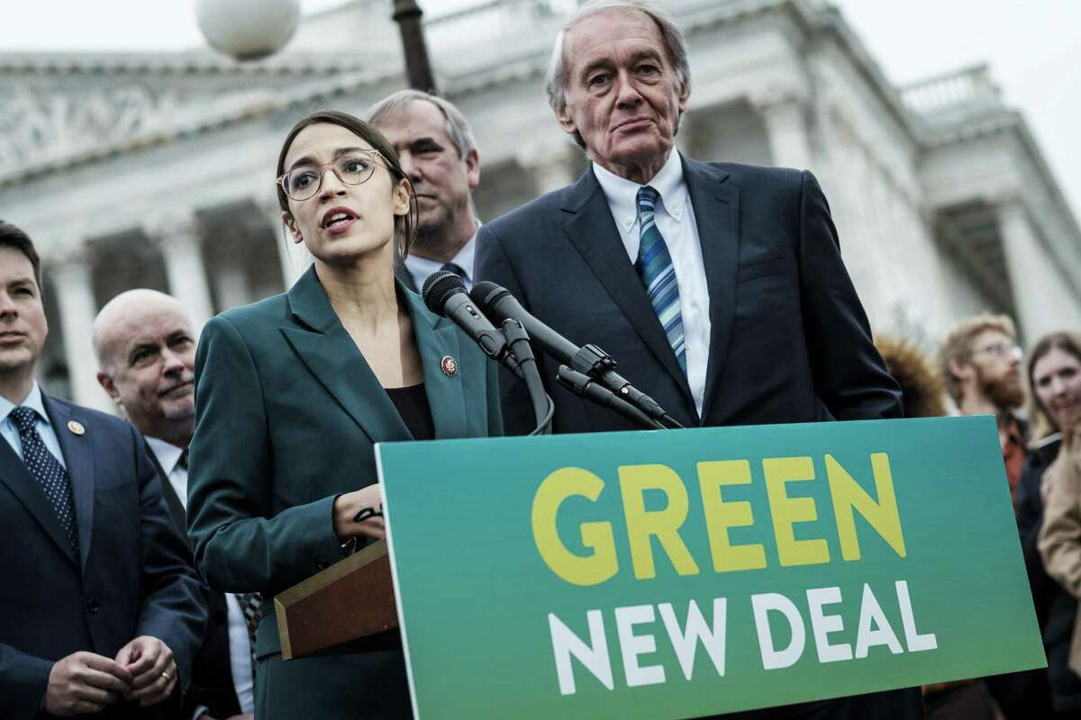 Rep. Alexandria Ocasio-Cortez (D-N.Y.) speaks alongside Sen. Ed Markey (D-Mass.) at a news conference about the Green New Deal. The last time climate change policy came up for a vote in 2009, Markey, then a representative, co-sponsored the legislation.