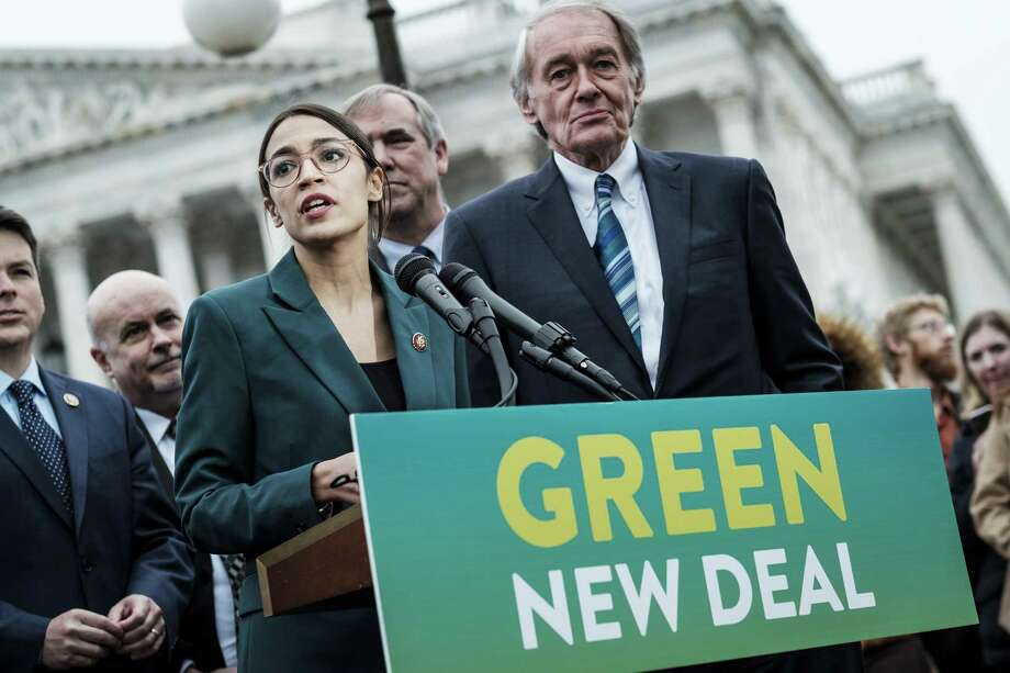 Rep. Alexandria Ocasio-Cortez (D-N.Y.) speaks alongside Sen. Ed Markey (D-Mass.) at a news conference about the Green New Deal. The last time climate change policy came up for a vote in 2009, Markey, then a representative, co-sponsored the legislation. Photo: PETE MAROVICH, STR / NYT / NYTNS
